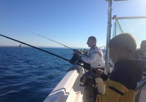 Pesca-in-barca-ginosa-2